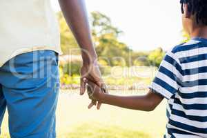 Focus on hands of son and father