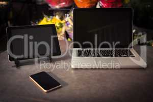 Laptop, digital tablet and mobile phone on the table