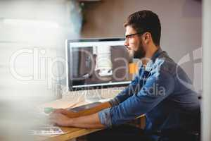 Graphic designer working at his desk