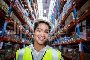 Smiling female worker holding clipboard
