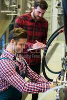 Maintenance workers examining pressure