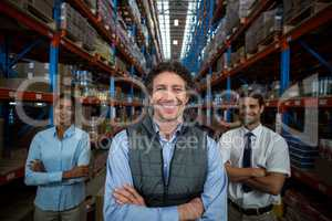 Focus of happy businessman posing face to the camera with his co