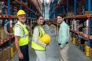 Portrait of manager and workers are standing and smiling to the