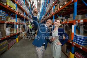 Managers are looking up and pointing shelves