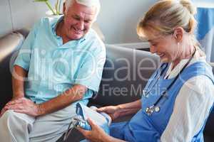 Nurse measuring the blood pressure of a senior man