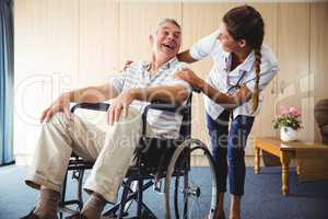Happy nurse smiling to his patient