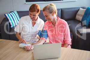 Nurse measuring the blood pressure of a senior woman