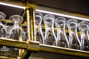 Wine glass and beer glass arranged on bar rack