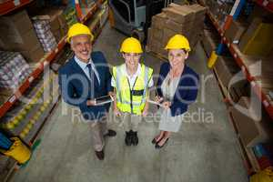 High angle view of managers and worker wearing hard hat and look