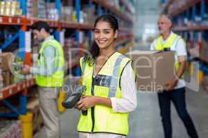 Happy worker posing and smiling to the camera in front of her co