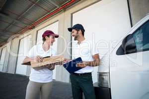Low angle view of delivery people are looking each other and lau