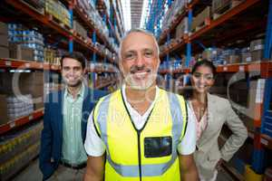 Focus of worker is smiling and posing in front of his managers