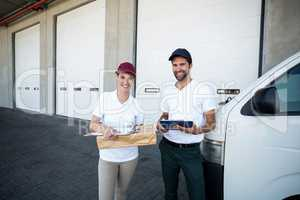 Portrait of delivery people are holding goods and posing