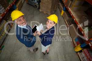 High angle view of managers are wearing hard hat and looking the