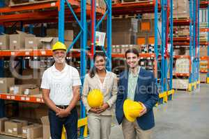 Portrait of managers are holding hard hat and posing
