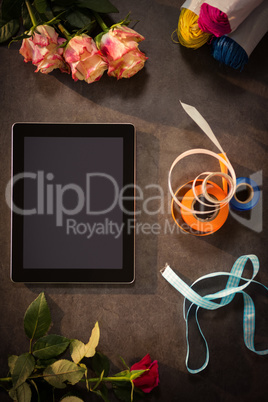 Digital tablet and florist accessories on the table