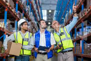 Worker looking up in warehouse