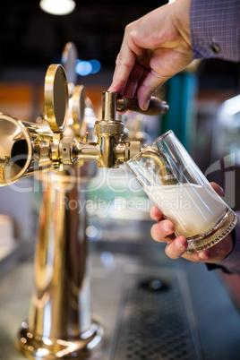 Bar tender pouring beer