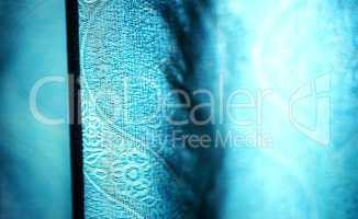 Horizontal vivid blue curtain bokeh background
