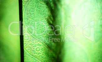 Horizontal vivid green curtain bokeh background