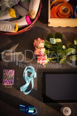 Digital tablet and florist supplies on the table