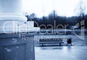 Horizontal vintage bluish bench in park bokeh background