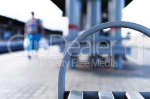 Horizontal vibrant bench on train station bokeh background backd
