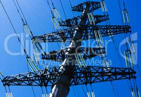 Horizontal vivid power lines closeup on blue sky background back