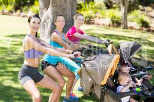 Women exercising with baby stroller