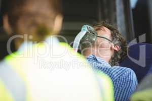 Close-up of an injured man wearing oxygen mask