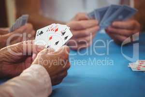 Retired people playing card
