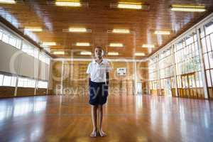 Boy standing in basketball court