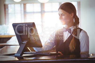 Waitress using a touchscreen