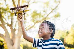 Happy child playing with a plane
