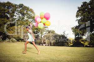 Daughter holding balloon