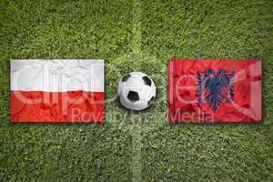 Poland vs. Albania flags on soccer field