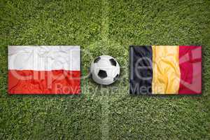 Poland vs. Belgium flags on soccer field
