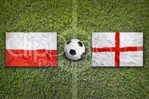 Poland vs. England flags on soccer field