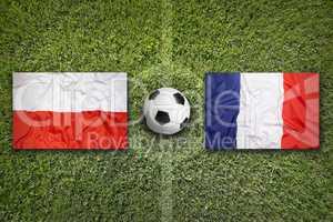Poland vs. France flags on soccer field
