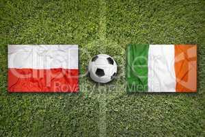 Poland vs. Ireland flags on soccer field