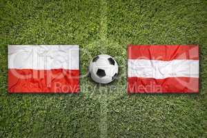 Poland vs. Austria flags on soccer field