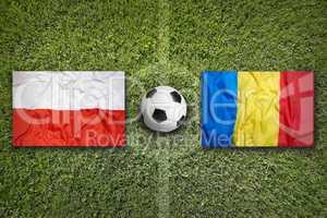 Poland vs. Romania flags on soccer field