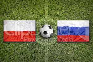 Poland vs. Russia flags on soccer field
