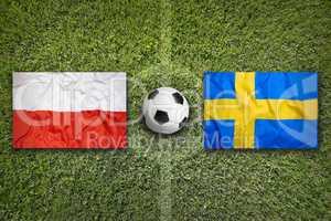 Poland vs. Sweden flags on soccer field
