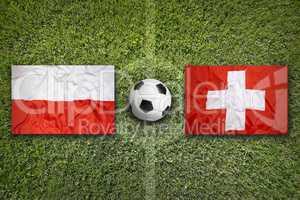 Poland vs. Switzerland flags on soccer field
