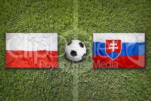 Poland vs. Slovakia flags on soccer field