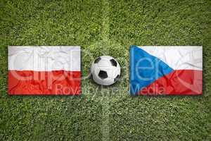 Poland vs. Czech Republic flags on soccer field