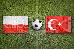 Poland vs. Turkey flags on soccer field