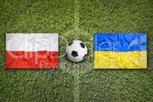 Poland vs. Ukraine flags on soccer field