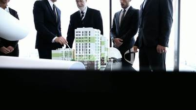 Architects and investors with model of houses